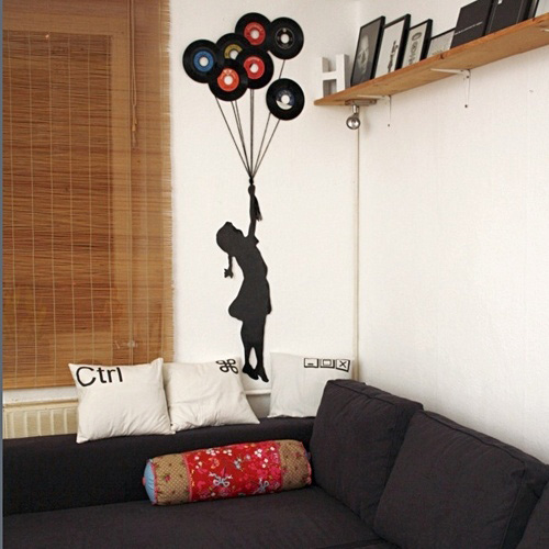 6 different ways to reuse old vinyl records six for Vinyl record wall art